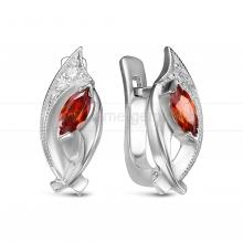 Серьги из серебра 925 пробы, украшенные красными фианитами. Артикул 12566