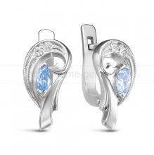 Кольцо из серебра 925 пробы, украшенное голубыми фианитами. Артикул 12579
